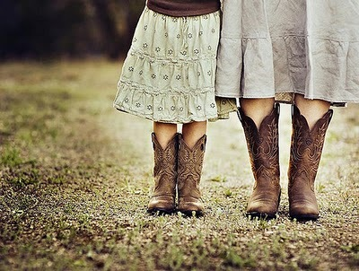 Mother and daughter wearing cowboy boots